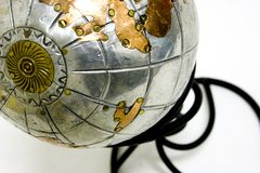 Metal world globe. Aluminum and copper globe of the earth on stand .. focus point the north pole Royalty Free Stock Images