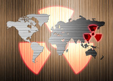 Metal world map and nuclear radiation leak. The metal world map and nuclear radiation leak Royalty Free Stock Images