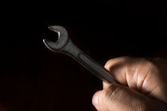 Metal wrench in human hand. Metal wrench in technician hand Stock Image