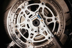 Metal wrench on motorcycle disk brake Stock Images