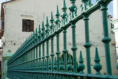 Metal wrought forged fence in perspective, closeup. Security, protection concept. Stock Photos