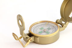 A metal, yellow compass Stock Photos