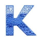 Metal Zeichen u. wässern Sie Tropfen - bezeichnen Sie K mit Buchstaben Lizenzfreies Stockfoto
