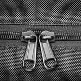Metal zipper on black synthetic fabric. Close  Metal zipper on black synthetic fabric Stock Images