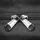 Metal zipper on black synthetic fabric. Close  Metal zipper on black synthetic fabric Royalty Free Stock Images