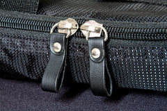 Metal zipper on black synthetic fabric Royalty Free Stock Photos