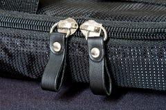 Metal zipper on black synthetic fabric. Close Metal zipper on black synthetic fabric Royalty Free Stock Photos