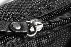 Metal zipper on black synthetic fabric. Close Metal zipper on black synthetic fabric Stock Image
