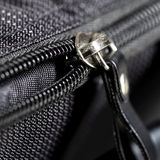 Metal zipper on black synthetic fabric Royalty Free Stock Photography