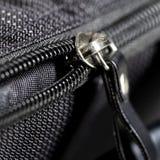 Metal zipper on black synthetic fabric. Closeup  Metal zipper on black synthetic fabric Royalty Free Stock Photography