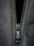 Metal zipper on black synthetic fabric. Open  Metal zipper on black synthetic fabric Stock Photo