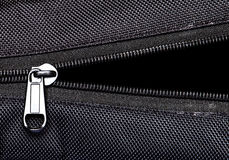 Metal zipper on black synthetic fabric Stock Image