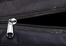 Metal zipper on black synthetic fabric. Open  Metal zipper on black synthetic fabric Stock Image