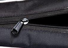 Metal zipper on black synthetic fabric. Open  Metal zipper on black synthetic fabric Stock Images