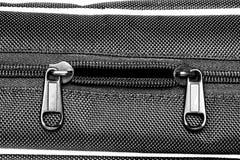 Metal zipper on black synthetic fabric. Open  Metal zipper on black synthetic fabric Stock Photography