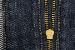 Metal zipper openning on blue jean with copy space for background. Royalty Free Stock Photo