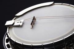 Metalic banjo isolated on black background Royalty Free Stock Photo