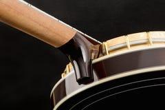Metalic banjo isolated on black background Stock Photo
