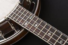 Metalic banjo isolated on black background Stock Photography