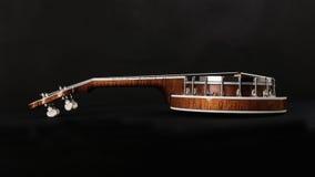 Metalic banjo isolated on black background Royalty Free Stock Photos