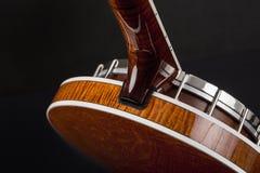 Metalic banjo isolated on black background Stock Images