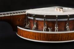 Metalic banjo isolated on black background Royalty Free Stock Images