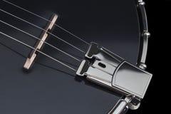 Metalic black banjo isolated on black background Royalty Free Stock Photos