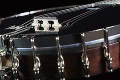 Metalic black banjo isolated on black background Royalty Free Stock Images