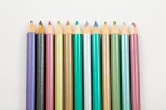 Metalic Colouring Pencils in a row Royalty Free Stock Photos