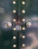 Metalic green door. Lens flare on metalic green door Royalty Free Stock Photography