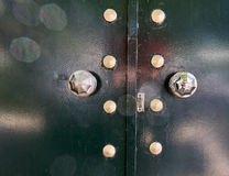 Metalic green door. Lens flare on metalic green door Royalty Free Stock Images