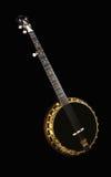 Metalic luxury golden banjo isolated on black background Stock Image