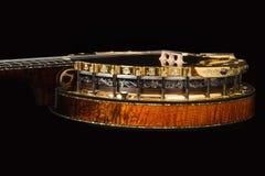 Metalic luxury golden banjo isolated on black background Royalty Free Stock Photography