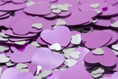 Metalic pink and silver hearts. Macro of metalic pink and silver hearts Stock Images
