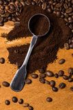 Metalic spoon and coffee. Over wooden surface Royalty Free Stock Photos