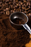 Metalic spoon and coffee. Over wooden surface Royalty Free Stock Photography