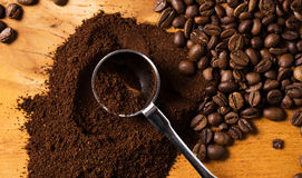 Metalic spoon and coffee. Over wooden surface Stock Image
