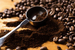 Metalic spoon and coffee. Over wooden surface Royalty Free Stock Image