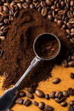 Metalic spoon and coffee. Over wooden surface Royalty Free Stock Photo