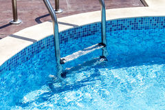 Metalic stairs of summer swimming pool Stock Photography