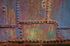 Metalic texture. Old corroded metalic surface with rivets Stock Image