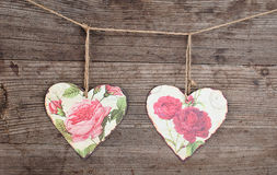 Metalichesky hearts. Two metal hearts on an old shabby wooden background stock images