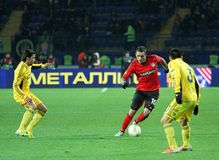Metalist Kharkiv vs Bayer Leverkusen match. KHARKIV, UA - NOVEMBER 22: Bayer Leverkusen MF Renato Augusto (C) in action during UEFA Europa League Group stage ( Stock Photo