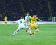 Metalist Kharkiv vs Rapid Wien football match. KHARKIV, UA - OCTOBER 4: Metalist Kharkiv FW Jonathan Cristaldo (R) in action during UEFA Europa League Group Royalty Free Stock Photo