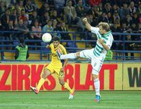 Metalist Kharkiv vs Rapid Wien football match. KHARKIV, UA - OCTOBER 4: Metalist Kharkiv MF Cleiton Xavier (L) in action during UEFA Europa League Group stage Stock Photos
