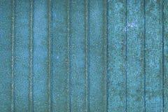 蓝色葡萄酒背景-镶边的生锈的metall纹理 免版税库存图片