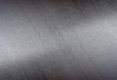 Metall borstad skinande yttersida för textur arkivbild