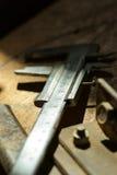Metall caliper on a table Stock Photo