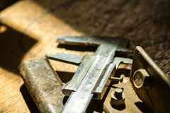 Metall caliper on a wooden table Royalty Free Stock Photography