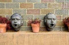 Metall-Childs-Kopf-Wand-Skulptur Lizenzfreie Stockbilder